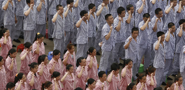Inmates take an oath to resist drugs at a ceremony to mark International Day Against Drug Abuse and Illicit Trafficking at a compulsory drug rehabilitation centre in Wuhan