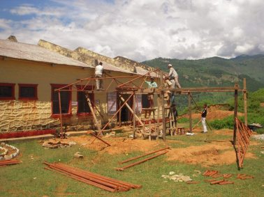 Repairs are conducted on a health clinic in Nepal