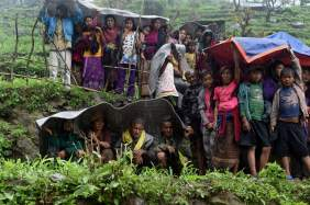 Nepalese villagers shelter from rain, which will only worsen as monsoon season hits. Source: Time Magazine