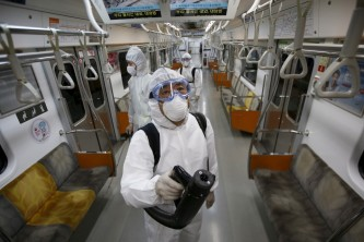Virologists screen a subway for traces of the MERS disease. Source: The Atlantic