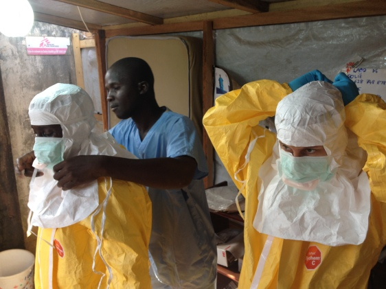 Medical providers prepare to enter an area contaminated with Ebola. Source: The Lutheran World Foundation