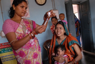 A community health worker in India vaccinates a child. Only 44% of children ages 1 to 2 are fully vaccinated in India. Source: Pippa Ranger, UK, DFD