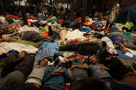 Refugees resting on the floor of the Keleti Railway Station in Budapest, Hungary. Source: Wikimedia Commons