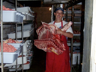 A worker in a slaughterhouse, preparing meat to be sent off for further processing and consumption. Source: Southern Foodways Alliance
