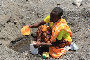 A woman collecting water in a dried up riverbed in northern Kenya during a drought. In 2011, the Government of Kenya declared a national disaster due to the drought which affected more than 3.5 million people in the country. Source: Marison Grandon/Dept. for Intl. Development