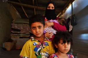Ratiba Awad pictured with her three children, Ouday, Ahraa, and Batoula (5 years, 4 years, and 7 months old resepctively). They live in an old cow shed with 20 other Syrian refugees who were also forced to abandon their homes during the Syrian war. Source: Trocaire