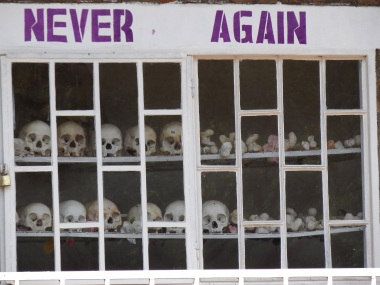 never_again_-_with_display_of_skulls_of_victims_-_courtyard_of_genocide_memorial_church_-_karongi-kibuye_-_western_rwanda_-_02
