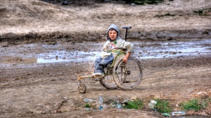 A wheelchair bound boy in Afghanistan struggles to traverse the poorly paved roads. Source: Flickr user hoschi