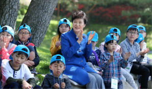 South Korean President Park Geun-Hye celebrates Children's Day with schoolchildren. Recent government policies have increased childcare infrastructure to decrease the burden of raising a family. Source: Republic of Korea, Flickr.